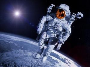 Astronauts experiencing no gravity are like realized souls experiencing no karma